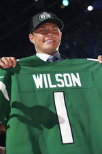 BYU quarterback Zach Wilson holds a New York Jets jersey after being selected second overall by the team in the first round of the NFL football draft, Thursday, April 29, 2021, in Cleveland. (AP Photo/Tony Dejak)