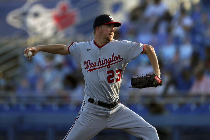 Washington Nationals starting pitcher Erick Fedde throws against the Toronto Blue Jays during the first inning of a baseball game Wednesday, April 28, 2021, in Dunedin, Fla. (AP Photo/Mike Carlson)