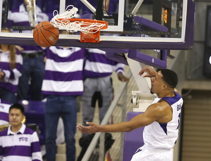 TCU guard Desmond Bane scores past Baylor on a fast break in the first half of an NCAA college basketball game, Saturday, Jan. 5, 2019, in Fort Worth, Texas. (Rod Aydelotte/Waco Tribune Herald via AP)