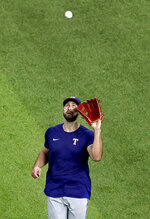 Texas Rangers outfielder Joey Gallo fields a fly ball during a