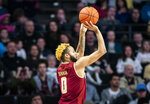Boston College guard Ky Bowman (0) shoots during an NCAA college basketball game against Wake Forest, Saturday, Jan. 26, 2019, in Winston-Salem, N.C. (Andrew Dye/The Winston-Salem Journal via AP)