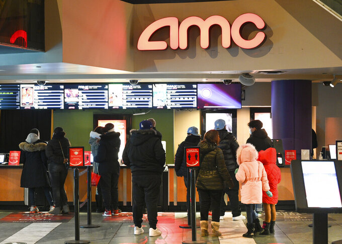 FILE - In this March 5, 2021 file photo, people line up for movie tickets at a reopened AMC theater in New York.  AMC said Wednesday, June 2,  that it's launching AMC Investor Connect, an initiative that will put the company in direct communication with its individual shareholders to keep them up to date about important company information and provide them with special offers.   (Photo by Evan Agostini/Invision/AP, File)