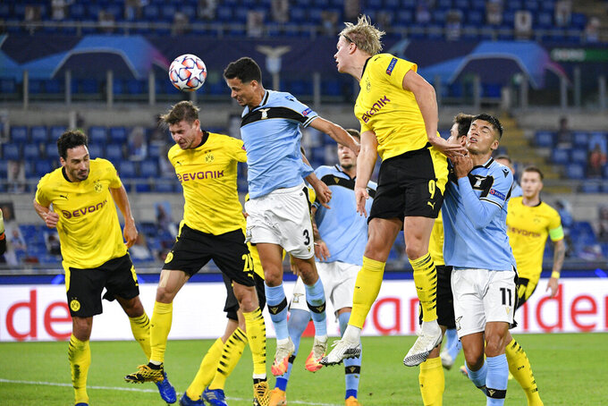 Lazio's Luiz Felipe Ramos, center, and Borussia Dortmund's defense vie for the ball during a group stage soccer match at the UEFA Champions League, Tuesday, Oct. 20, 2020 in Rome, Italy. (Fabrizio Corradetti/LaPresse via AP)