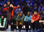 Portland Trail Blazers Seth Curry watches players shoot during the NBA All-Star 3-Point contest, Saturday, Feb. 16, 2019, in Charlotte, N.C. (AP Photo/Chuck Burton)