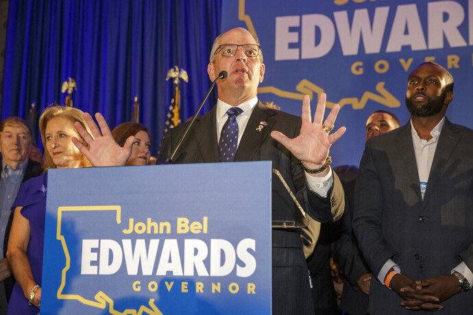 Louisiana Gov. John Bel Edwards speaks at his election night watch party in Baton Rouge, La., Saturday, Oct. 12, 2019. (AP Photo/Brett Duke)