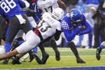 Kentucky running back Asim Rose scores a touchdown as he is tackled by Louisville defensive back Isaiah Hayes (33) during the first half of the NCAA college football game, Saturday, Nov. 30, 2019, in Lexington, Ky. (AP Photo/Bryan Woolston)