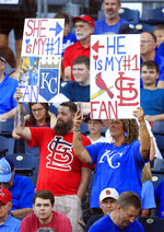 Fans hold signs during the first inning of a baseball game between the Kansas City Royals and the St. Louis Cardinals at Kauffman Stadium in Kansas City, Mo., Wednesday, Aug. 14, 2019. (AP Photo/Orlin Wagner)