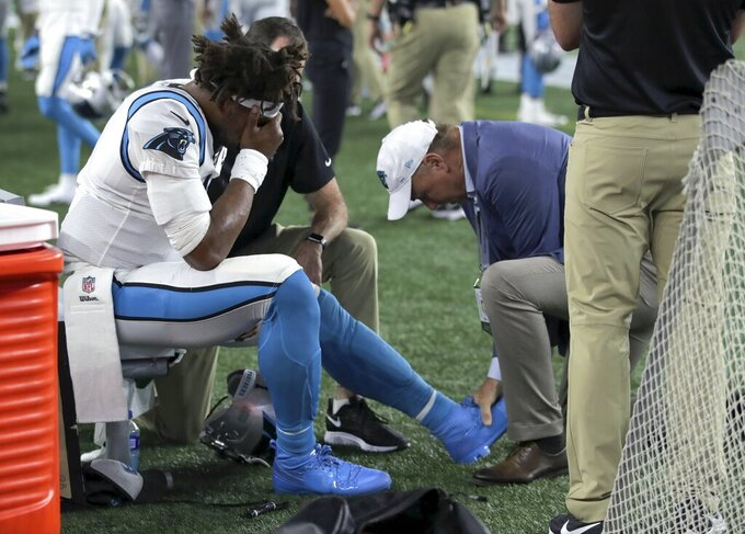 Panthers hoping Newton's injured left foot 'not too bad'