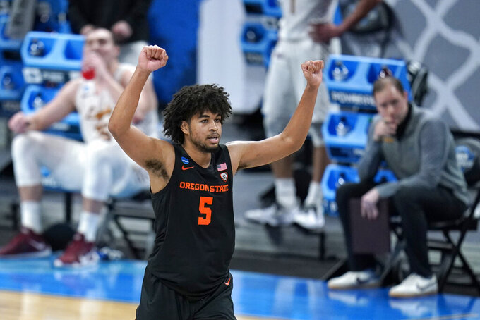 Oregon State guard Ethan Thompson celebrates during the second half of a Sweet 16 game against Loyola Chicago in the NCAA men's college basketball tournament at Bankers Life Fieldhouse, Saturday, March 27, 2021, in Indianapolis. (AP Photo/Jeff Roberson)
