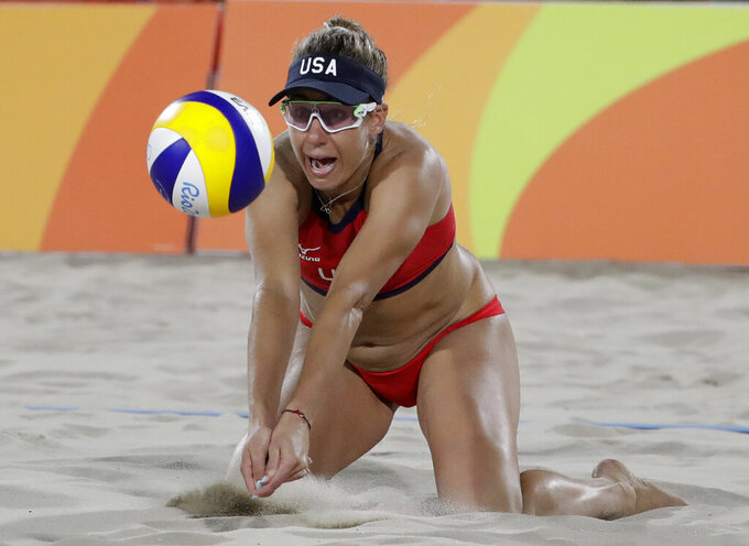 FILE - In this Wednesday, Aug. 17, 2016 file photo, The United States' April Ross passes a ball while playing against Brazil during the women's beach volleyball bronze medal match of the 2016 Summer Olympics in Rio de Janeiro, Brazil. Two-time Olympic beach volleyball medalist April Ross has a rare opportunity to relax with 100 days to go before the Tokyo Games. That doesn't mean that she will. Ross and partner Alix Klineman are the No. 1 team in the Olympic qualification rankings and the only Americans who have already clinched one of four likely spots for U.S. beach teams in the pandemic-delayed 2020 Games. (AP Photo/Marcio Jose Sanchez, File)