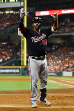 Washington Nationals' Kurt Suzuki celebrates after a home run during the seventh inning of Game 2 of the baseball World Series against the Houston Astros Wednesday, Oct. 23, 2019, in Houston. (AP Photo/Matt Slocum)