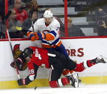 New York Islanders defenseman Adam Pelech (3) checks Ottawa Senators right wing Connor Brown (28) during first-period NHL hockey game action in Ottawa, Ontario, Friday, Oct. 25, 2019. (Fred Chartrand/The Canadian Press via AP)