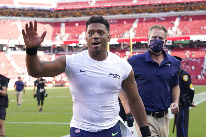 Seattle Seahawks quarterback Russell Wilson waves after the Seahawks defeated the San Francisco 49ers in an NFL football game in Santa Clara, Calif., Sunday, Oct. 3, 2021. (AP Photo/Tony Avelar)