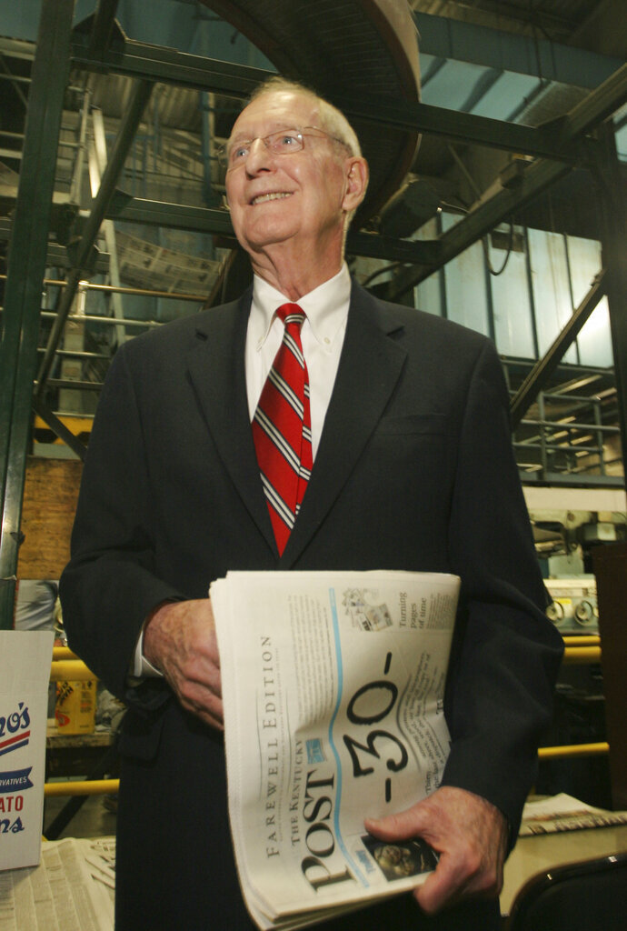 FILE - In this Dec. 31, 2007 file photo, William Keating, former Cincinnati Enquirer publisher, holds one of the final Kentucky Post newspapers off the press in Cincinnati. The former congressman and newspaper executive has died on Wednesday, May 20, 2020 according to his family. (AP Photo/Tom Uhlman, File)