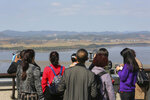 Visitors watch the North Korea side from the Unification Observation Post in Paju, South Korea, near the border with North Korea, Tuesday, Oct. 15, 2019. Amid swine fever scare that grips both Koreas, South Korea is deploying snipers, installing traps and flying drones along the rivals' tense border to kill wild boars that some experts say may have spread the animal disease from north to south. (AP Photo/Ahn Young-joon)