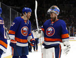 New York Islanders left wing Matt Martin (17) and goaltender Semyon Varlamov (40) celebrate after the team's 3-2 win over the Tampa Bay Lightning in Game 4 of an NHL hockey Stanley Cup semifinal, Saturday, June 19, 2021, in Uniondale, N.Y. (AP Photo/Jim McIsaac)