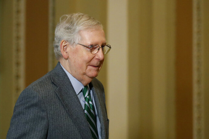 Senate Majority Leader Mitch McConnell, R-Ky., leaves the Senate chamber on Capitol Hill in Washington, Thursday, Jan. 16, 2020. (AP Photo/Julio Cortez)