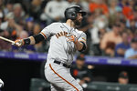 San Francisco Giants' Brandon Belt follows the flight of his single off Colorado Rockies relief pitcher Daniel Bard in the seventh inning of a baseball game Saturday, Sept. 25, 2021, in Denver. (AP Photo/David Zalubowski)