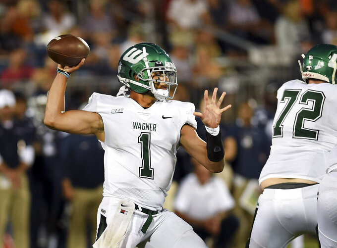 Wagner quarterback Christian Alexander-Stevens (1) sets to pass during the first half of the team's NCAA college football game against Connecticut on Thursday, Aug. 29, 2019, in East Hartford, Conn. (AP Photo/Stephen Dunn)