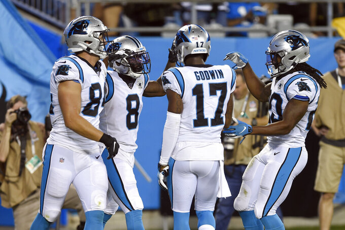 Carolina Panthers wide receiver Aldrick Robinson (8) is congratulated by teammates tight end Jason Vander Laan (84), wide receiver Terry Godwin (17) and running back Jordan Scarlett (20) following Robinson's touchdown against the Pittsburgh Steelers during the first half of an NFL preseason football game in Charlotte, N.C., Thursday, Aug. 29, 2019. (AP Photo/Mike McCarn)
