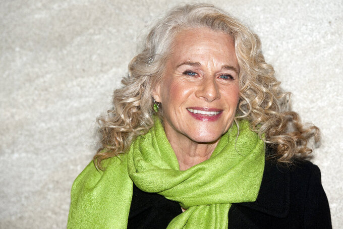 FILE - In a Wednesday, Nov. 30, 2011 file photo, Carole King attends the Rockefeller Center Christmas tree lighting, in New York. King will be inducted to the Rock & Roll Hall of Fame. The ceremony, to be held at the Rocket Mortgage Fieldhouse in Cleveland, will be simulcast on SiriusXM and air later on HBO. (AP Photo/Charles Sykes, File)