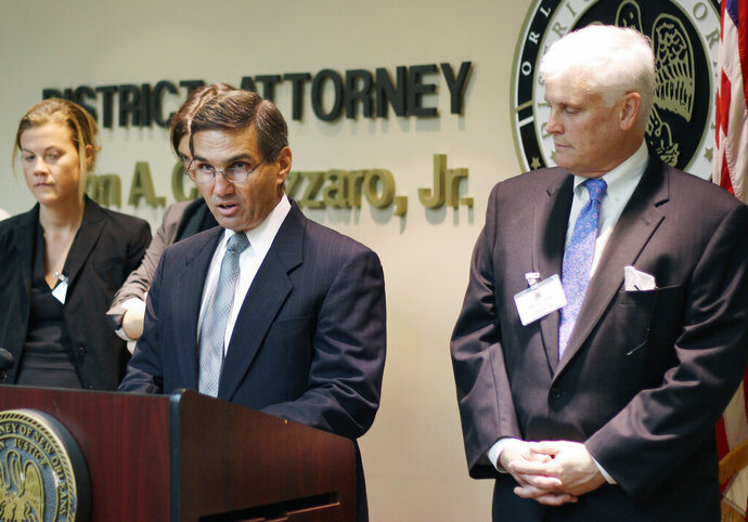 FILE - In this May 12, 2014 file photo, Orleans Parish District Attorney Leon Cannizzaro speaks at a news conference in New Orleans. Lawyers for the district attorney are asking a federal appeals court to end a lawsuit centered on his office having used fake subpoenas to coerce uncooperative witnesses. Attorneys representing Cannizzaro and some of his staff were set to argue Wednesday, Feb. 5, 2020, that the prosecutors are legally immune from claims made in a 2017 lawsuit by criminal justice advocates. The case is before a three-judge panel of the 5th U.S. Circuit Court of Appeals. (AP Photo/Janet McConnaughey, File)