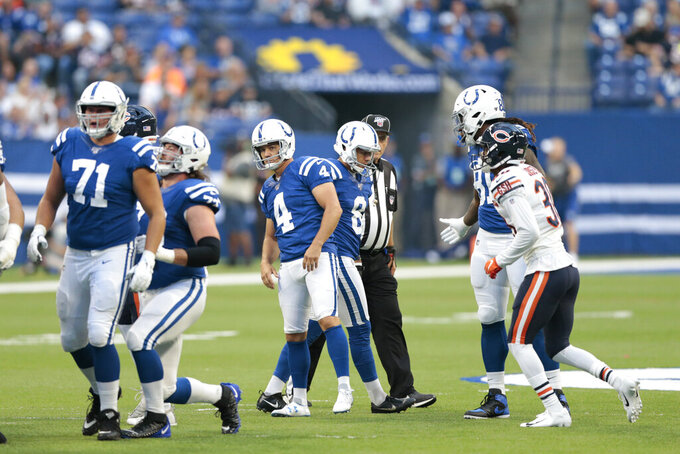 CORRECTS TO 49-YARD, INSTEAD OF 44-YARD, FIELD GOAL - Indianapolis Colts kicker Adam Vinatieri (4) watches a 49-yard field goal during the first half of the team's NFL preseason football game against the Chicago Bears, Saturday, Aug. 24, 2019, in Indianapolis. (AP Photo/AJ Mast)