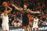 Southern California's Derryck Thornton defends against Oregon State's Stephen Thompson Jr. during the first half of an NCAA college basketball game in Corvallis, Ore., Thursday, Jan. 10, 2019. (AP Photo/Amanda Loman)