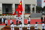 A flag raising ceremony is held at the Golden Bauhinia Square to mark the anniversary of the Hong Kong handover to China in Hong Kong, Wednesday, July 1, 2020. Hong Kong marked the 23rd anniversary of its handover to China in 1997, one day after China enacted a national security law that cracks down on protests in the territory.(AP Photo/Kin Cheung)