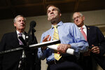 Rep. Jim Jordan, R-Ohio, center, speaks with members of the media after former deputy national security adviser Charles Kupperman signaled that he would not appear as scheduled for a closed door meeting to testify as part of the House impeachment inquiry into President Donald Trump, Monday, Oct. 28, 2019, on Capitol Hill in Washington. Standing with Jordan are Rep. Mark Meadows, R-N.C., left, and Rep. Michael Conaway, R-Texas. (AP Photo/Patrick Semansky)