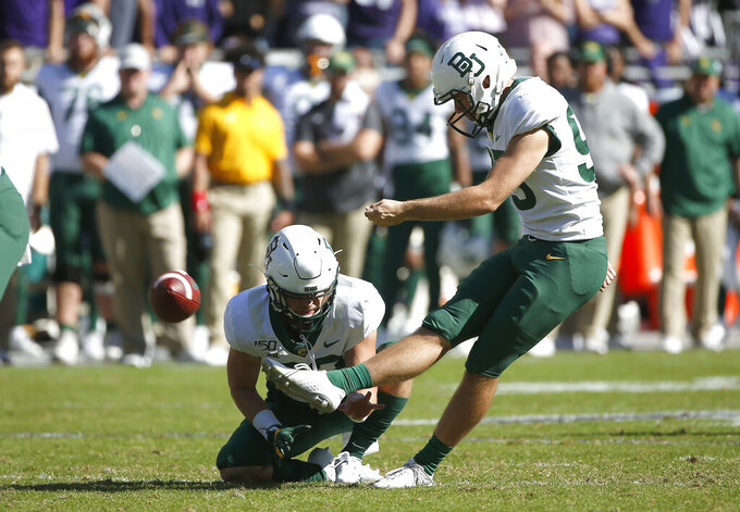 Baylor place kicker John Mayers (95) kicks a field goal as holder Skyler Wetzel (32) holds against TCU during the second half of an NCAA college football game, Saturday, Nov. 9, 2019, in Fort Worth, Texas. Baylor won 29-23 in triple overtime. (AP Photo/Ron Jenkins)