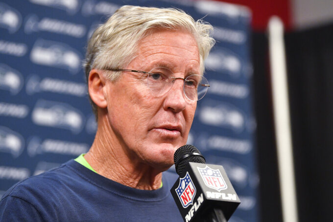 Seattle Seahawks head coach Pete Carroll speaks during a news conference after an NFL football game against the Atlanta Falcons, Sunday, Oct. 27, 2019, in Atlanta. The Seattle Seahawks won 27-20. (AP Photo/John Amis)