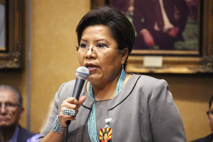 FILE - In this Jan. 11, 2017, file photo, Arizona Sen. Jamescita Peshlakai, a Democrat from the Navajo Nation community of Cameron, addresses a joint Senate and House session in Phoenix. Arizona lawmakers are poised Thursday, May 23, 2019, to consider tripling the amount of cash they are paid for each day they work in new legislation that emerged as their yearly session nears a close. Peshlakai said as a working mother she struggles with expenses needed to get to and stay in Phoenix and to travel her wide-ranging district to meet with constituents. (AP Photo/Bob Christie, File)