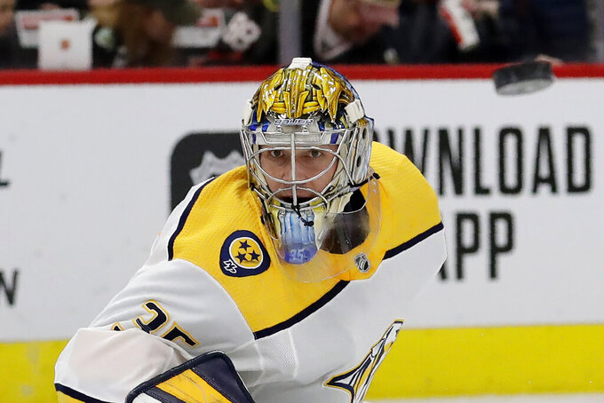 FILE - In this Feb. 21, 2020, file photo, Nashville Predators goalie Pekka Rinne waits for the puck during the first period of an NHL hockey game against the Chicago Blackhawks in Chicago. The NHL's pause has the clock ticking on the career of a former Vezina Trophy winner and four-time finalist with Rinne turning 38 in November. (AP Photo/Nam Y. Huh, File)