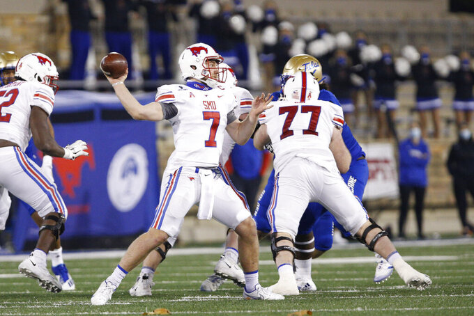 SMU quarterback Shane Buechele (7) throws a pass against Tulsa during the second half of an NCAA college football game in Tulsa, Okla., Saturday, Nov. 14, 2020. (AP Photo/Joey Johnson)