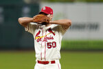 St. Louis Cardinals starting pitcher Adam Wainwright pauses on the mound after giving up a solo home run to Milwaukee Brewers' Daniel Vogelbach during the fourth inning of a baseball game Saturday, Sept. 26, 2020, in St. Louis. (AP Photo/Jeff Roberson)
