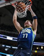 Dallas Mavericks forward Luka Doncic dunks during the first half of an NBA basketball game against the San Antonio Spurs, Thursday, Dec. 26, 2019, in Dallas. (AP Photo/Brandon Wade)