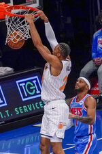 Orlando Magic center Khem Birch (24) dunks past Brooklyn Nets guard Bruce Brown during the first half of an NBA basketball game, Saturday, Jan. 16, 2021, in New York. (AP Photo/Mary Altaffer)