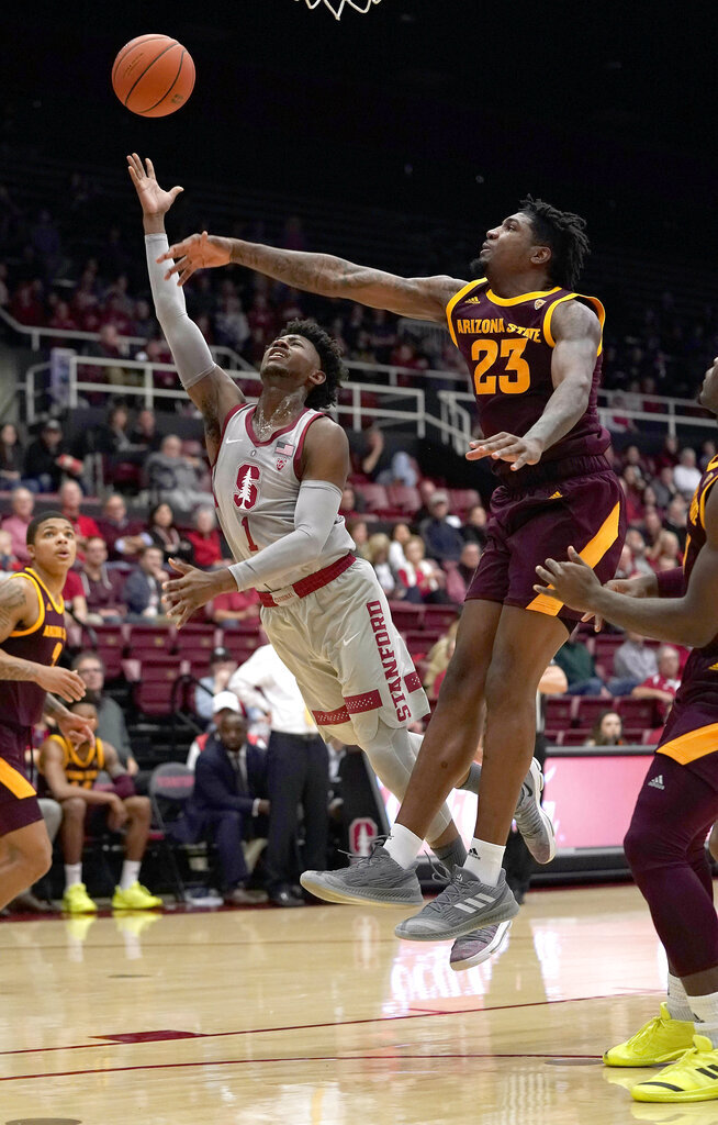 Stanford guard Daejon Davis (1) releases a shot next to Arizona State forward Romello White (23) during the first half of an NCAA college basketball game in Stanford, Calif., Saturday, Jan. 12, 2019. (AP Photo/Tony Avelar)