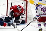 New York Rangers left wing Chris Kreider (20) scores a goal past Washington Capitals goaltender Vitek Vanecek (41) in the third period of an NHL hockey game, Wednesday, Oct. 13, 2021, in Washington. The Capitals won 5-1. (AP Photo/Alex Brandon)