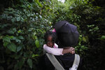 A man carries a girl as migrants continue their trek north, near Acandi, Colombia, Wednesday, Sept. 15, 2021. The migrants, mostly Haitians, are on their way to crossing the Darien Gap from Colombia into Panama dreaming of reaching the U.S. (AP Photo/Fernando Vergara)