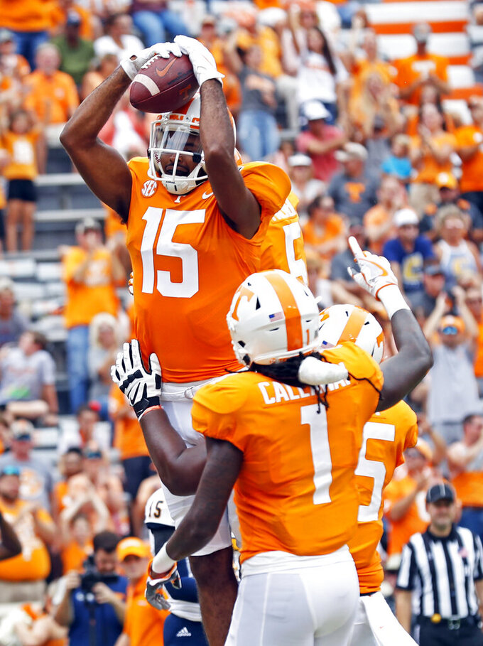 Tennessee wide receiver Jauan Jennings (15) celebrates scoring a touchdown with teammate wide receiver Marquez Callaway (1) in the first half of an NCAA college football game against Chattanooga, Saturday, Sept. 14, 2019, in Knoxville, Tenn. (AP Photo/Wade Payne)