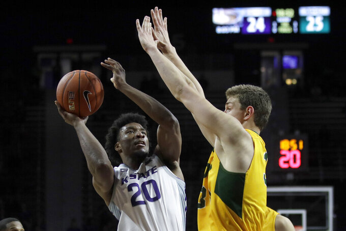 Kansas State forward Xavier Sneed (20) shoots while covered by North Dakota State forward Rocky Kreuser, right, during the second half of an NCAA college basketball game in Manhattan, Kan., Tuesday, Nov. 5, 2019. (AP Photo/Orlin Wagner)