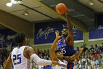 Kansas center Udoka Azubuike (35) slaps the ball away from Chaminade guard Andre Arissol (10) during an NCAA college basketball game Monday, Nov. 25, 2019, in Lahaina, Hawaii. (AP Photo/Marco Garcia)