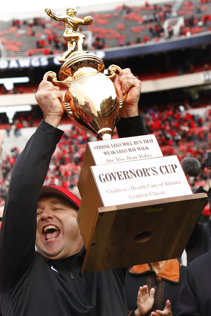 Georgia coach Kirby Smart lifts the Governor's Cup after an NCAA college football game against Georgia Tech, Saturday, Nov. 24, 2018, in Athens, Ga. (Joshua L. Jones/Athens Banner-Herald via AP)
