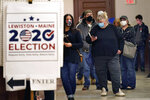 Residents wait to cast their absentee ballots during early voting, Friday, Oct. 30, 2020, in Lewiston, Maine. (AP Photo/Robert F. Bukaty)