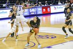 South Carolina guard Brea Beal (12) waits for LSU guard Khayla Pointer (3) to come down before shooting during an NCAA college basketball game in Baton Rouge, La., Sunday, Jan. 24, 2021. (AP Photo/Matthew Hinton)