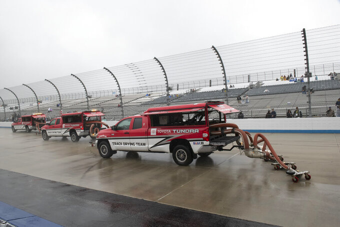 Track drying team works to dry the track before the start of the Gander RV 400 - Monster Energy NASCAR Cup Series Race, Sunday, May 5, 2019, at Dover International Speedway in Dover, Del. (AP Photo/Jason Minto)