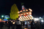 In this Tuesday, Dec. 3, 2019, photo,  a lantern-covered float leans as it goes to the town central square during the Chichibu Night Festival in Chichibu, north of Tokyo, Japan. Moving six towering floats up a hill and into the town center is the culminating moment of a Shinto festival that has evolved from a harvest thanksgiving into a once-a-year meeting between two local gods. (AP Photo/Toru Hanai)