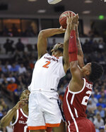 Virginia's Braxton Key (2) attempts to shoot over Oklahoma's Kristian Doolittle (21) during the second half of a second-round men's college basketball game in the NCAA Tournament in Columbia, S.C., Sunday, March 24, 2019. (AP Photo/Richard Shiro)